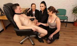 3 clothed women de-robe a stud naked and suck his cock dry too