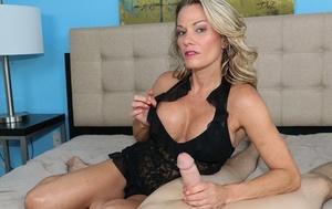 Huge-boobed blonde MILF Allura Skye shows cleavage while giving POV handjob