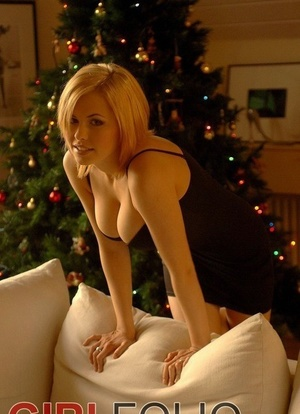 Hot light-haired Iga unleashes her great tits while decorating Christmas tree