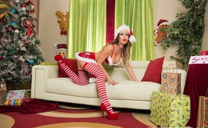 Pornstar Jessica Jaymes produces a POV bj for Xmas in naughty attire