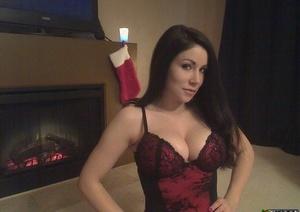 Sexy brunette Sweet Krissy posing topless on her knees in black thong panties