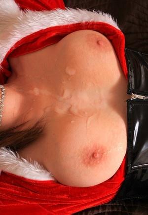 Brunette plumper sports cum on big breasts after a handjob in a Santa clothing