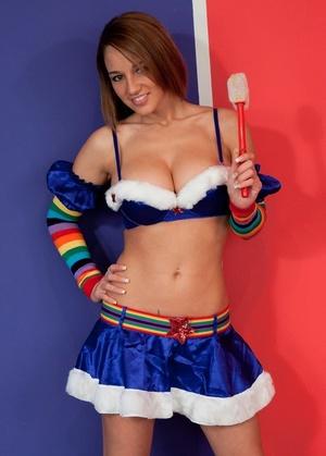 Erotic model Nikki Sims in rainbow knee socks and micro skirt teasing braless