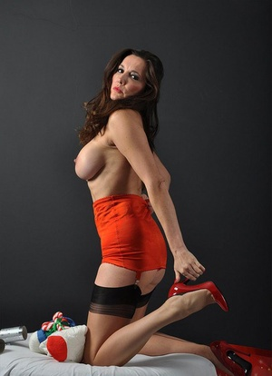 Older Mummy Nylon Jane shows off her long legs in nylons in Xmas attire