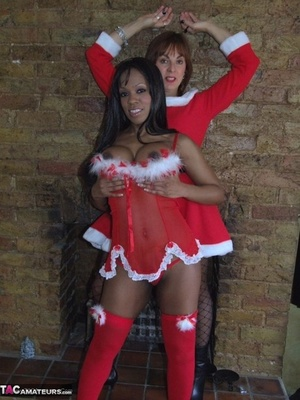 Middle-aged black and white females exposes themselves in Christmas outfit