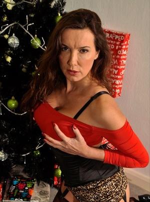 Clothed older damsel Nylon Jane exposes her upskirt panties in tan nylons