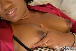 Thick black chick Sydnee Capri toys her shaved pussy in solo action