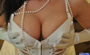 Sweet Krissy in white leather & lace lingerie strips to pose bare in gloves