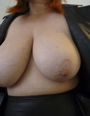 Fat redhead Mrs Leather bares huge tits before a cumshot on leather pants