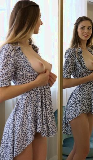 Busty Russian girl Sandra Phoenix fingers her pink slit afore a mirror