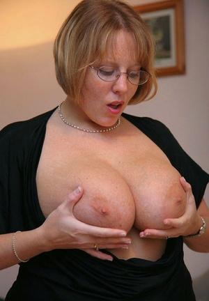 Fat amateur Curvy Claire pulls her large tits out from under her clothing
