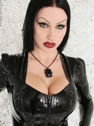 Goth model Vampirabat sets a large breast free of long latex dress
