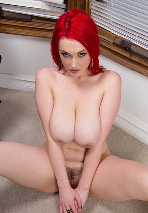 Jiggish redhead sweetie revealing her amazingly ample melons and trimmed slit