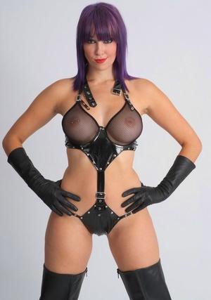Erotic model Sammi posing in revealing sheer lingerie and long leather gloves