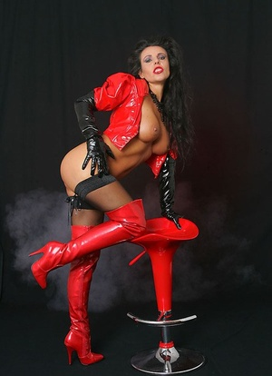 Black-haired lady Model Eve tout her naked ass in red stripper boots