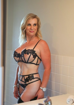 Fantastic mature blonde Sammi Rox in sheer lace undergarments toying pussy close up