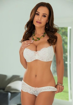 Brunette housewife Lisa Ann uncups her fat tits in lace underwear