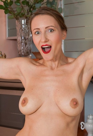 Hot housewife Alena K peels to spread naked ass & jack in the kitchen