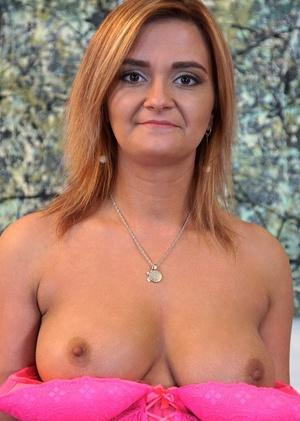 Busty housewife Ksukotzol fingers her shaved vagina after lingerie removal