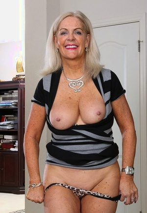 Older mature Judy Mayflower revealing large boobies to spread nude pussy lips