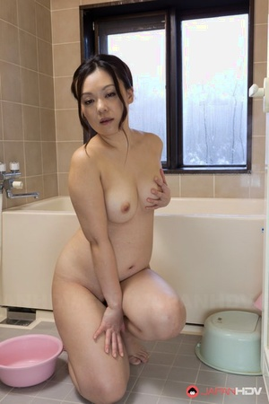Chubby Japanese girl An Kanoh has help from a man in fondling her breasts