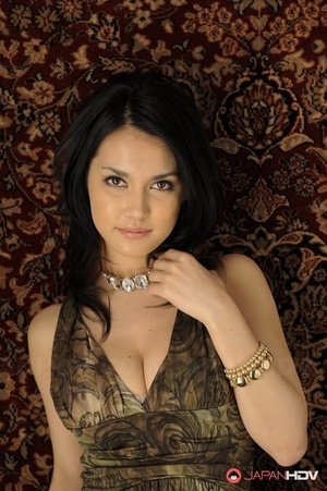 Japanese bombshell Maria Ozawa models non nude in a dress and jewelry