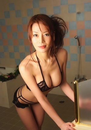 Beautiful Japanese model uncovers her great tits during solo activity