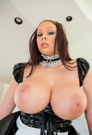Dark-haired chick Gianna Michaels frees her fat boobs from maid's garment