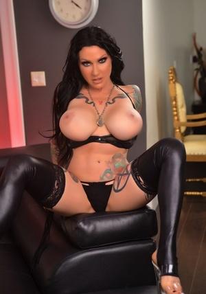 Tattooed hot pornstar Jen Hexxx in latex lingerie flaunting massive big tits
