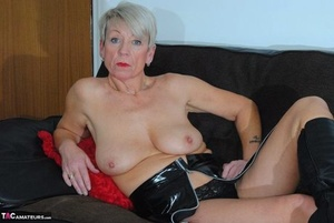 Steaming granny ShazzyB takes off spandex dress to model topless on couch