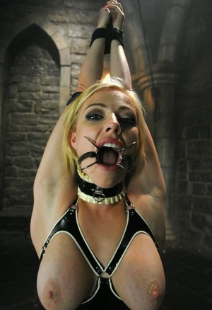 Busty blonde MILF Adrianna Nicole disciplined and facefucked in the dungeon