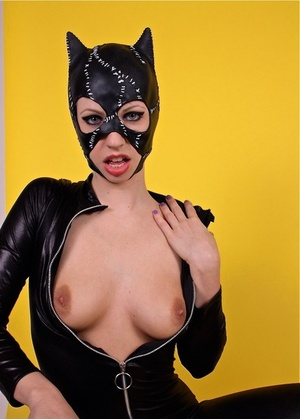 Naughty cat dame Lynn Pops pops her sexy tits out of seductive latex outfit