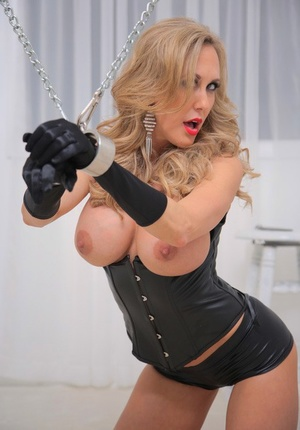 Busty blonde Brandi Enjoy submits to an Asian masculine in ebony corset and gloves
