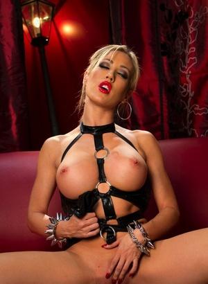 Blondie fetish model Capri Cavanni in leather displaying closeup cooter & big tits