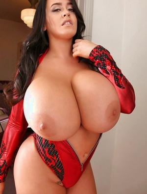 Big-tit babe Leanne Crow poses topless in her spandex suite in close-up