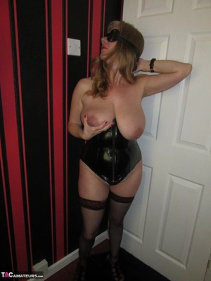 Blonde doll from the UK with huge tits pleasures herself in fetish attire