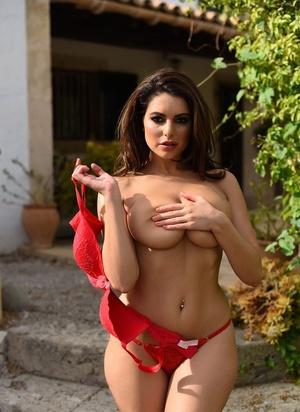 Beautiful brunette Charley S removes her red hooter-sling to sun her sexy big boobs