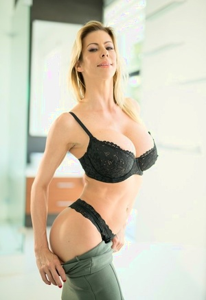 Sexy blonde sheds black lace lingerie to free phat enormous titties in the bathroom