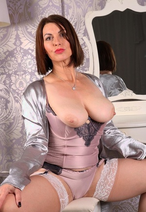 Older sexy Raven displays big tits in satin lingerie shows ass on her knees