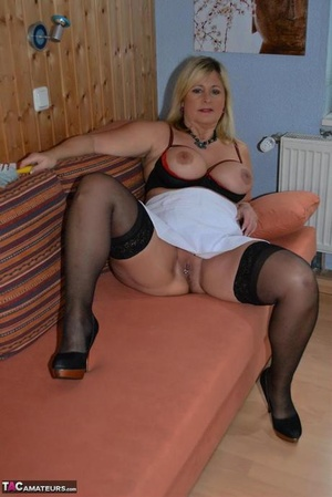 Thick mature MILF Nude Chrissy does her housework in cupless bra and pantyhose
