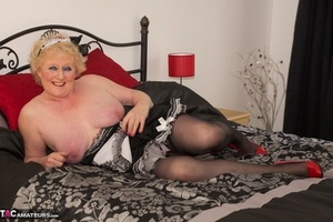 Old woman wanks her horny cunt wearing a French maid outfit and heels