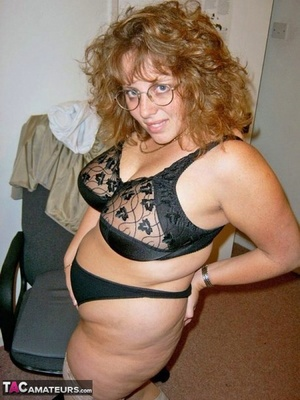 Mature redhead Curvyclaire dons thigh high footwear after stripping to lingerie