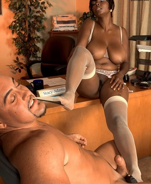 Black businesswoman Stacy Adams receives foot worship before intercourse