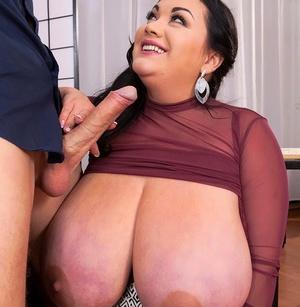 Brunette BBW Nila Mason seduces a man in her office wearing a taut skirt