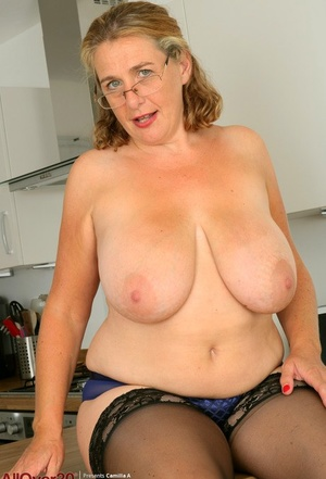 Mature plumper Camilla A bares her huge boobs and pussy at breakfast nook