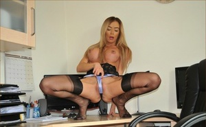 Super hot secretary shows her nice ass in garters and hosiery on office desk