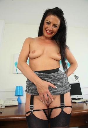 British secretary Roxanne sticks a finger in her twat wearing backseam nylons