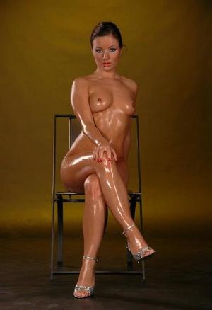 Naked Jana Mrazkova all oiled up and masturbating her pussy with a vibrator