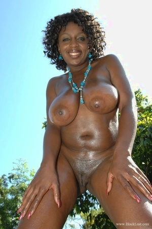 Ebony female Ms Panther uncovers melons before showing her bald vagina