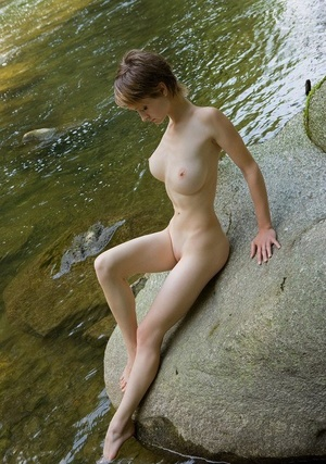 Hot big titted Silke sheds her hood to enjoy a naked paddle in the river